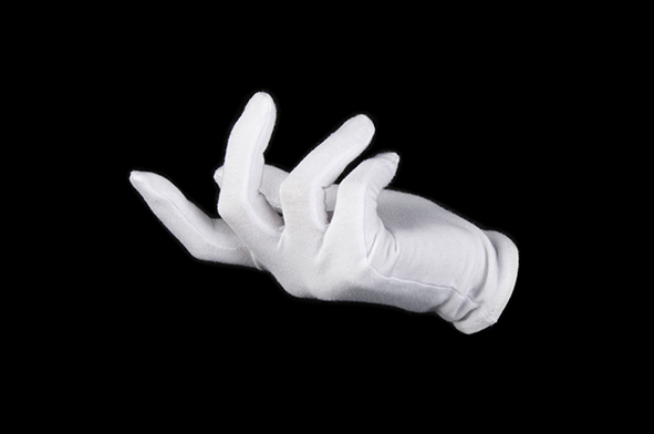 Stink: A white gloved right hand viewed side on against a black background beckons to an unseen presence