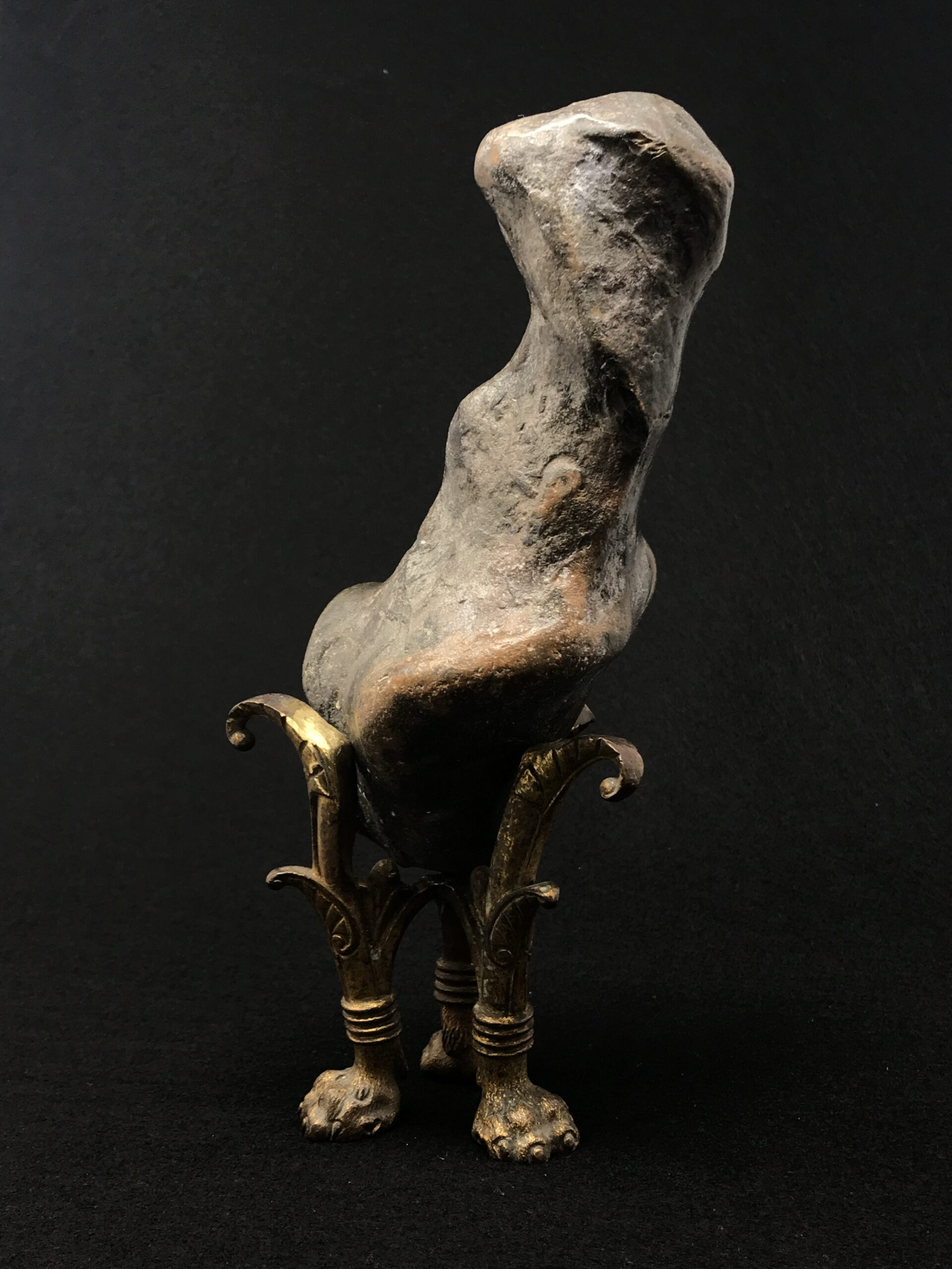 Collecting: a rock creature peers out of the gloom from his ornate gilded legs