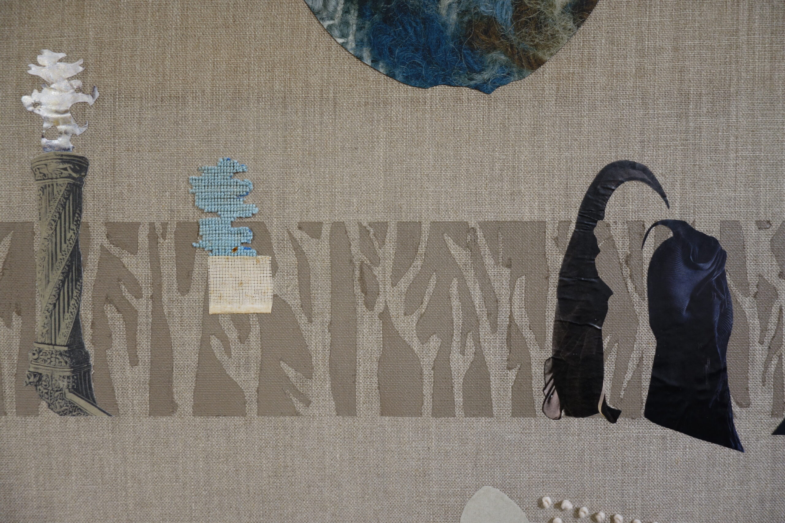 When much had been forgotten: fragments of tapestry, collage and embroidery in the shape of statues and organic forms are scattered across a pale grey-brown linen