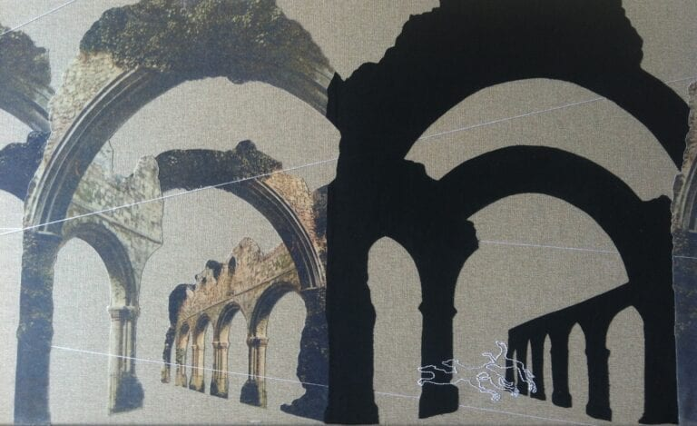 Trace: two sets of arches, one in a pale sandy stone with overgrown ivy and the other, identical in outline but a flat black silhouette, sitting on a mid-grey linen canvas. The outlines of three greyhounds are stitched in white thread, leaping through the arches