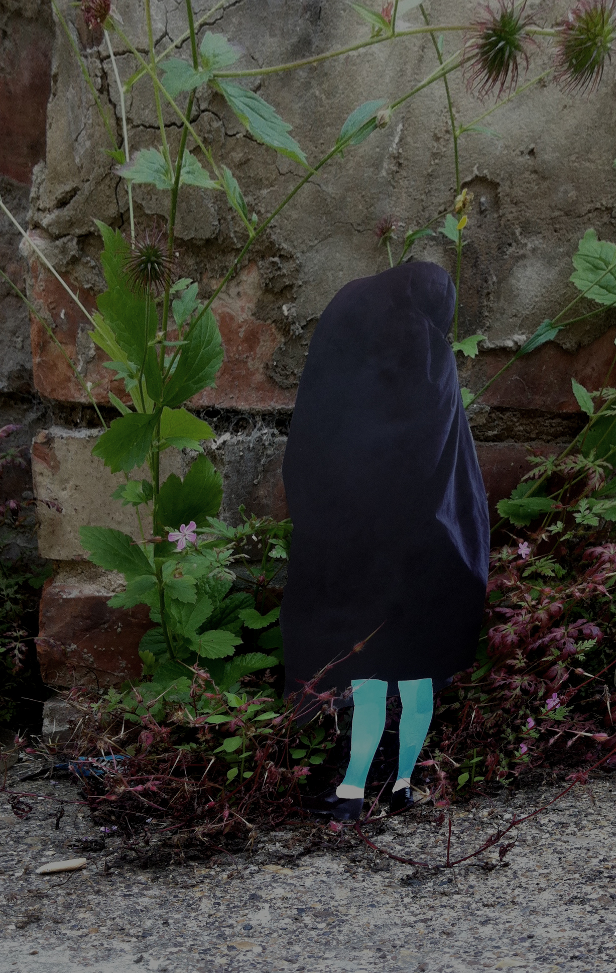A walk in the woods: a blue-legged figure with a dark cloth over their head and body stands against a brick wall with plants growing round it