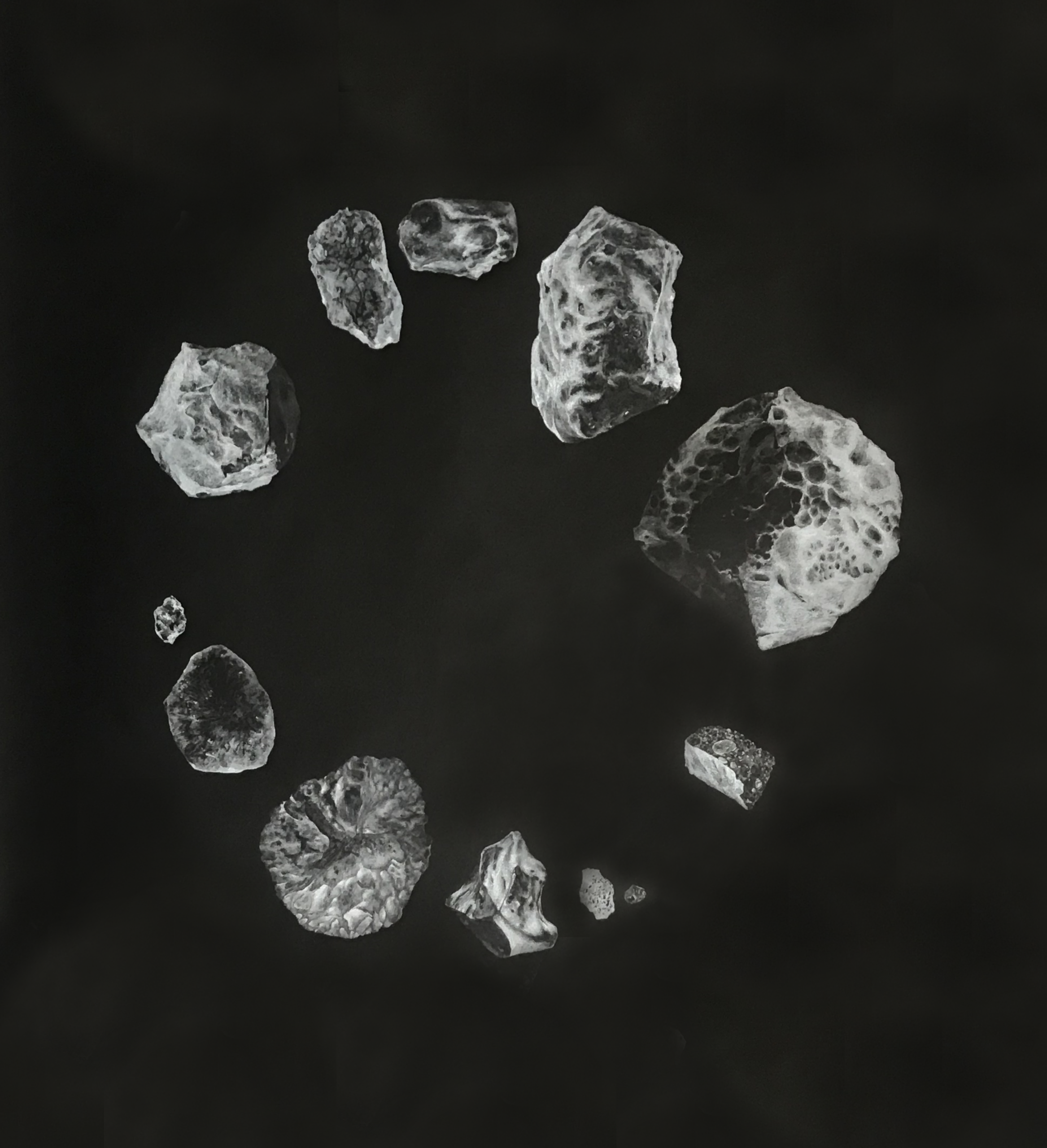 black paper with a drawing in white of a circle of 12 meteorites that have landed in the UK
